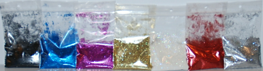Glitters from left to right: black, blue, fuchsia, gold, iridescent, red, silver. 10g size shown.